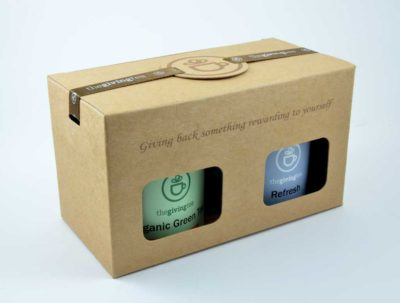 2 tea tins in kraft paper box. Text screen on box.