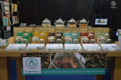 The Giving Tea booth at Impact