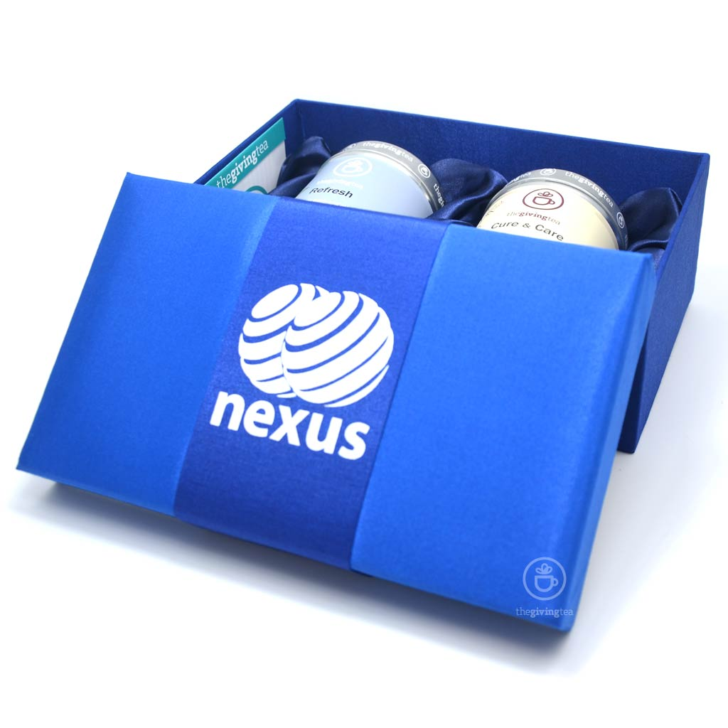 Nexus company. 2 tea tins in silk box